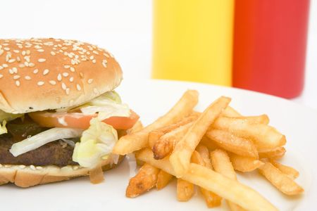 american hamburger with french fries isolated against white background photo