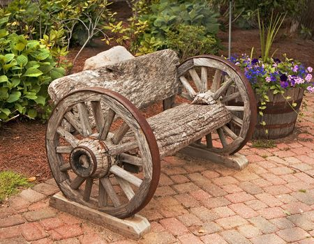 antique bench made from carriage wheels