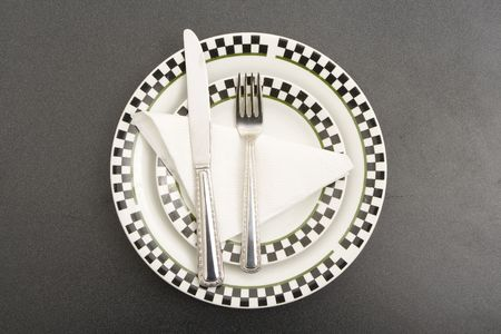 fork plate and knife on a table photo