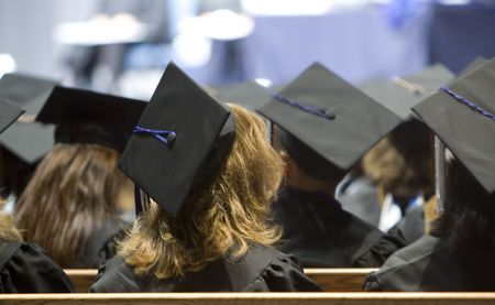graduates getting ready to take their diploma on a commencement ceremony