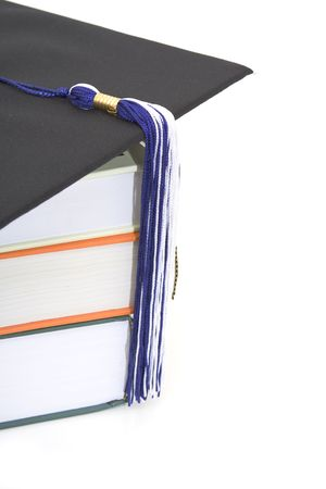 credentials: graduation cap and books isolated against white background Stock Photo
