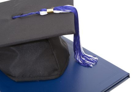 graduation cap and diploma isolated against white background Stock Photo - 3343843