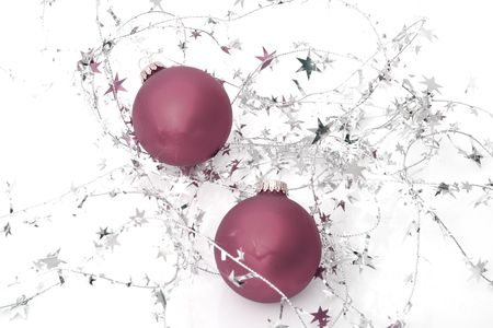 two red ornaments with stars isolated on a white background Stock Photo