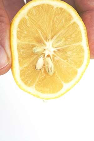 hand squeezing lemon isolated against white background Stok Fotoğraf