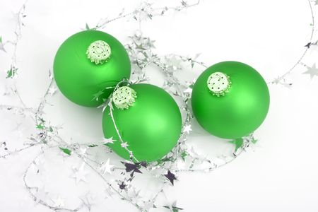 green ornament with silver stars isolated against white background photo