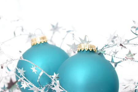 two ornaments with silver stars isolated against white background