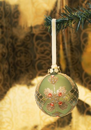 beautiful ornament hanging on a pine tree branch