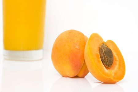 studio shot of fresh apricots with juice isolated against white background Stock Photo