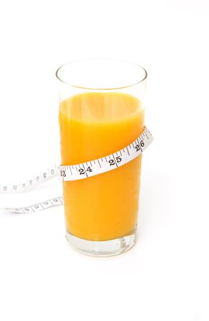 glass of tasty orange juice with measuring tape isolated against white background