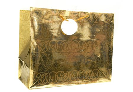 golden gift bag with tag isolated against white background Stok Fotoğraf