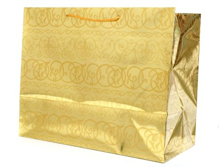 golden gift bag isolated against white background