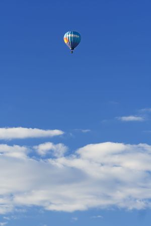hot air balloon high in the sky Stock Photo
