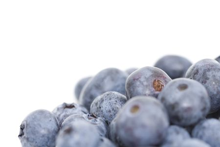 pile of blueberries isolated against white backround