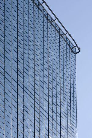 tall skyscraper with blue background   Stok Fotoğraf