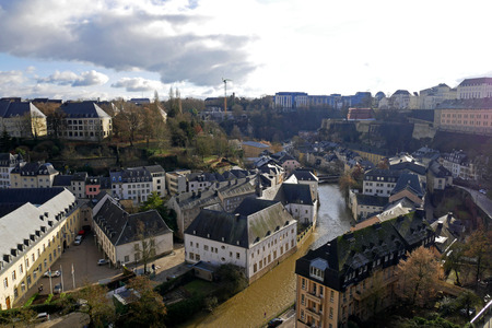 Luxembourg City view from Le Chemin de la Corniche or Balcony of Europe. Alzette river, church of St Jean du Grund and Abbey of Neumunster 写真素材