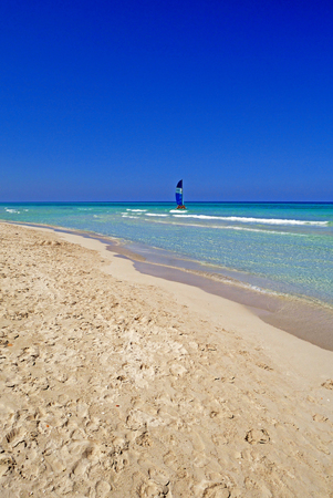 Varadero beach in Cuba with a calm turquoise ocean.