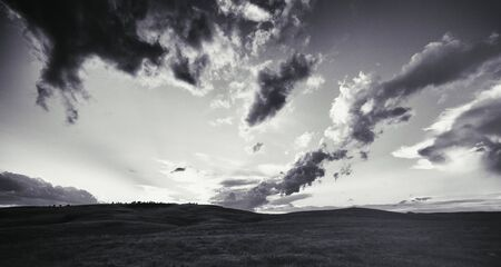 Black and white photo of western prairie with cloudscape