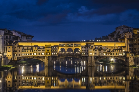vechio: Ponte Vecchio in Florence, Italy with water  reflection at Night Stock Photo