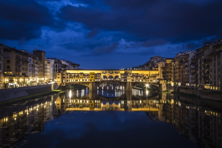 vechio: Ponte Vecchio in Florence with water reflection Stock Photo