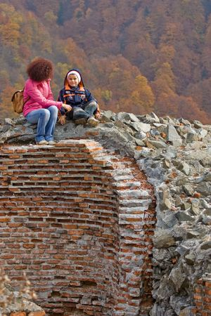 Mother and son contemplating the view from the ruins of Dracula's fortress Stock Photo - 1987141