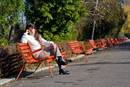 dissappointed: Dissappointed woman sitting on a bench in a park