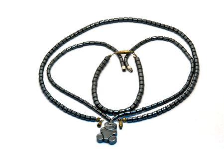 black onyx: Black onyx necklaces and bracelet isolated on white background Stock Photo
