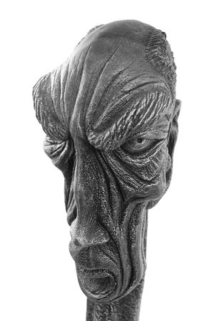 Sculpture representing an old man isolated on white background photo