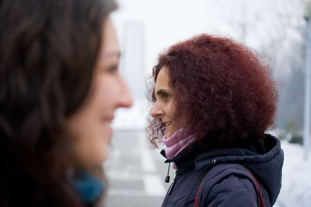 misunderstanding: Concept of misunderstanding with two women talking in the wrong direction