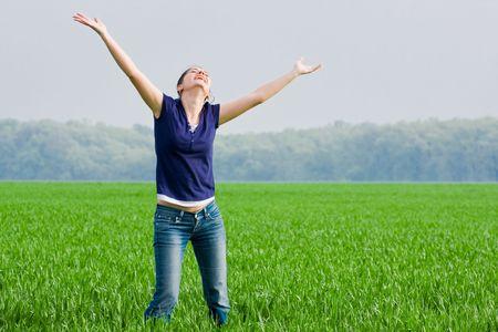 grassfield: Portrait of a pretty young woman in a grassfield