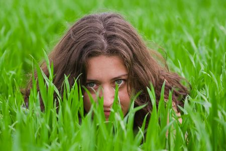 grassfield: Portrait of a beautiful woman in a grassfield