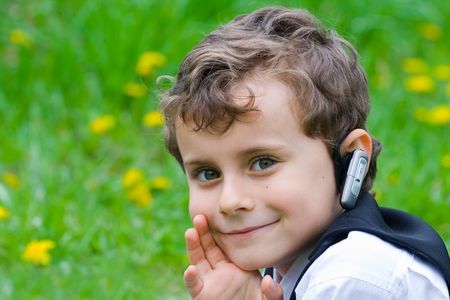 seven years: Seven years old businessman with mobile technology Stock Photo