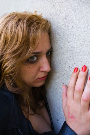 Portrait of an abused blond woman near a wall Stock Photo - 2993844