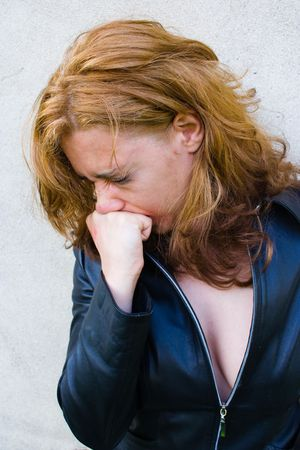 Portrait of an abused blond woman near a wall Stock Photo - 2993835