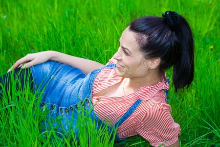 Pretty brunette having a good time outdoors photo