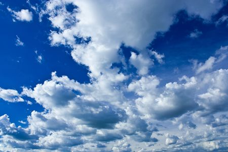 Background with beautiful blue sky and fluffy clouds Stock Photo