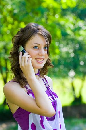 Blonde girl with blue eyes speaking on phone Stock Photo - 3225882