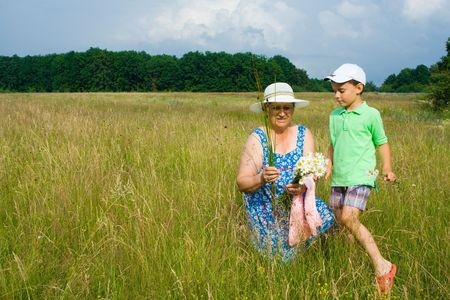Old woman and her grandson having a good time outdoor Stock Photo - 3250752