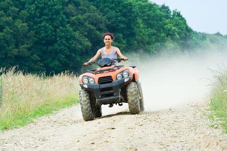 Woman riding an All Terrain Vehicle (ATV)