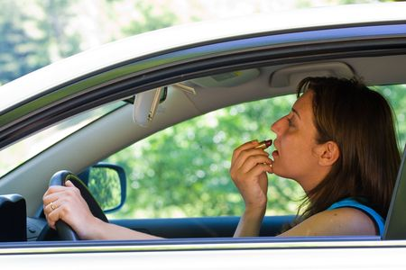 Woman doing make-up while driving Stock Photo - 3281677