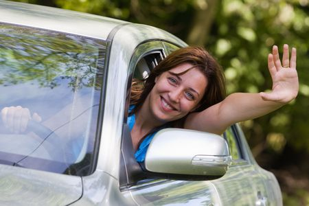 Young woman happy about her new car photo