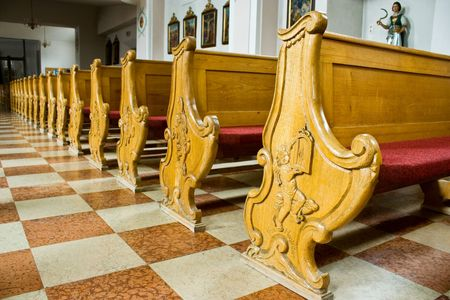 Wooden benches in a church photo