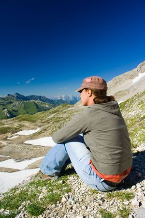 Portrait of a young woman admiring the beautiful view of Alps Stock Photo - 3414329