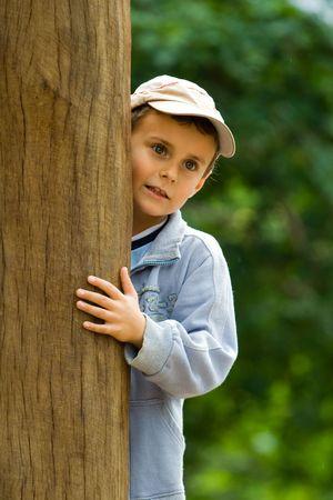 Pretty little boy hiding Stock Photo - 3414323