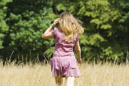 Young blond woman walking to the forest Stock Photo - 3538223