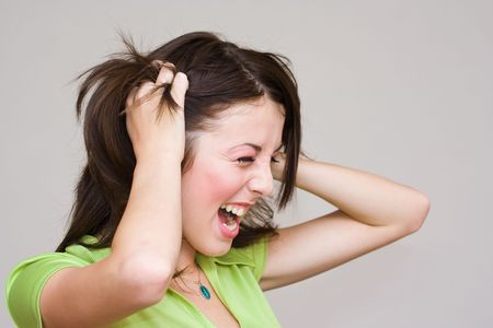 Close-up portrait of a beautiful woman screaming Stock Photo - 3607944