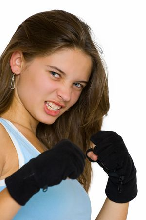 girl punch: Portrait of a beautiful young girl posing as a kickbox fighter