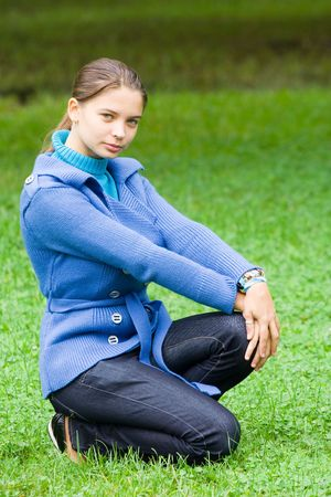 Beautiful young woman with blue coat outdoors photo