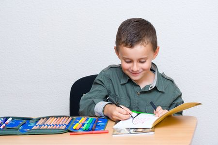 Portrait of a cute schoolboy drawing Stock Photo - 3683285