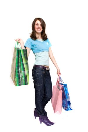 Young woman with bags shopping for , isolated on white photo