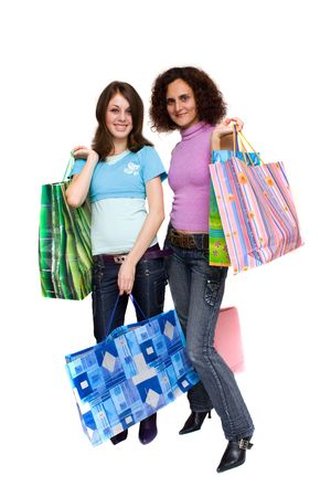 Two young women with bags shopping for , isolated on white photo